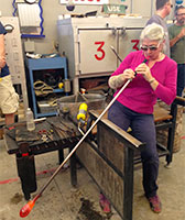 Bromberg demonstrates glass-blowing technique