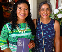 Monona Wali (right) with student Rosa Melendez at a book launch party held in June