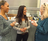 Jocelyn Winn (left) and student Jodi Shannahan (right) chat with Lois Leonhardi