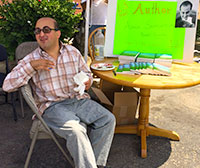 Amin at a book signing for his novel,