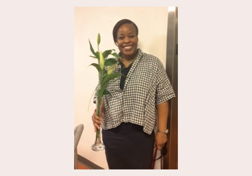 Customer Service Training instructor Dyonne Woolen received flowers from her grateful students