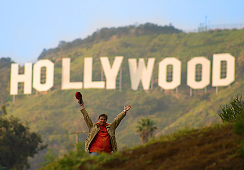 Simone celebrating beneath the Hollywood Sign