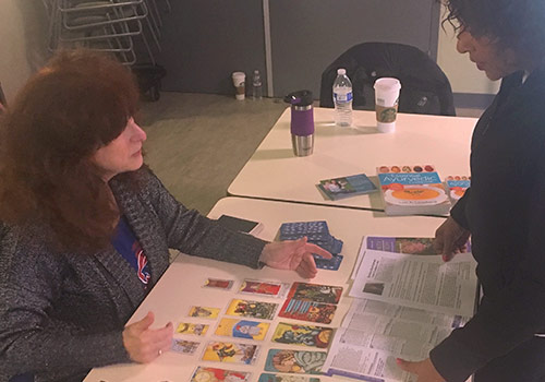 Tarot instructor Davida Rappaport discusses Tarot with an Open House attendee