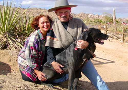Cecilia Dighero with her late husband Ron House and their dog Josie on their Joshua Tree property