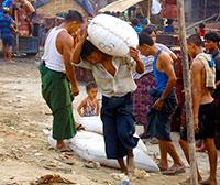 Myanmar - Men Unloading Boat